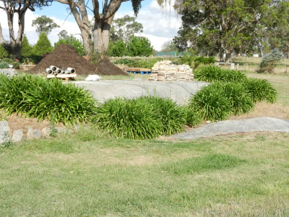 Before area where lower pond was put - plus materials for use in the garden